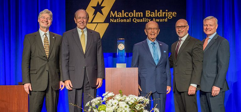 Photo with Rich Panico and Larry Meyer receiving the Malcolm Baldrige award